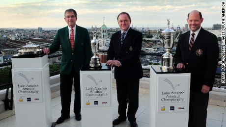 BUENOS AIRES, ARGENTINA - JANUARY 21:  (L-R) Billy Payne, Chairman of Augusta National Golf Club and Masters Tournament, Peter Dawson, Chief Executive The R&A and Mike Davis, Executive Director United States Golf Association, pose with the trophies during the Latin America Amateur Championship Initiatives at Sheraton Park Tower on January 21, 2014 in Buenos Aires, Argentina. (Photo by Amilcar Orfali/Getty Images for Latin America Amateur Championship)