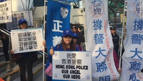 Police supporters chant slogans hold up banners in support of the seven convicted Hong Kong policemen.