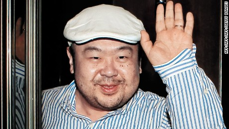 "In a picture taken on June 4, 2010 Kim Jong-Nam, the eldest son of North Korean leader Kim Jong-Il, waves after an interview with South Korean media representatives in Macau.  Kim Jong-Nam was in the limelight with Seoul's JoongAng Ilbo newspaper carrying a snatched interview with him at a hotel in Macau. Jong-Nam declined knowledge of the warship incident, it reported, and said his father is ""doing well"".  North Korean Leader  Leader Kim Jong-Il on June 7 attended a rare second annual session of parliament at which Kim's brother-in-law was promoted and the country's prime minister was sacked, state media reported.  REPUBLIC OF KOREA OUT  AFP PHOTO / JOONGANG SUNDAY VIA JOONGANG ILBO (Photo credit should read JoongAng Sunday/AFP/Getty Images)"