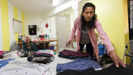 Jeanette Vizguerra unpacks clothes Tuesday night after moving into the church.