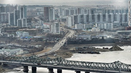 Residential areas of Pyongyang.. Looking out over the frozen Taedong river.
