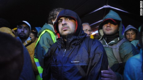 October 10, 2015- Asem Hasna, 21, waits together with thousands of refugees  in huge queues in the cold rain for more thnn 15 hours  to cross the borders from Serbia (Sid) towards Croatia (Opatovac)  (Maro Kouri)
