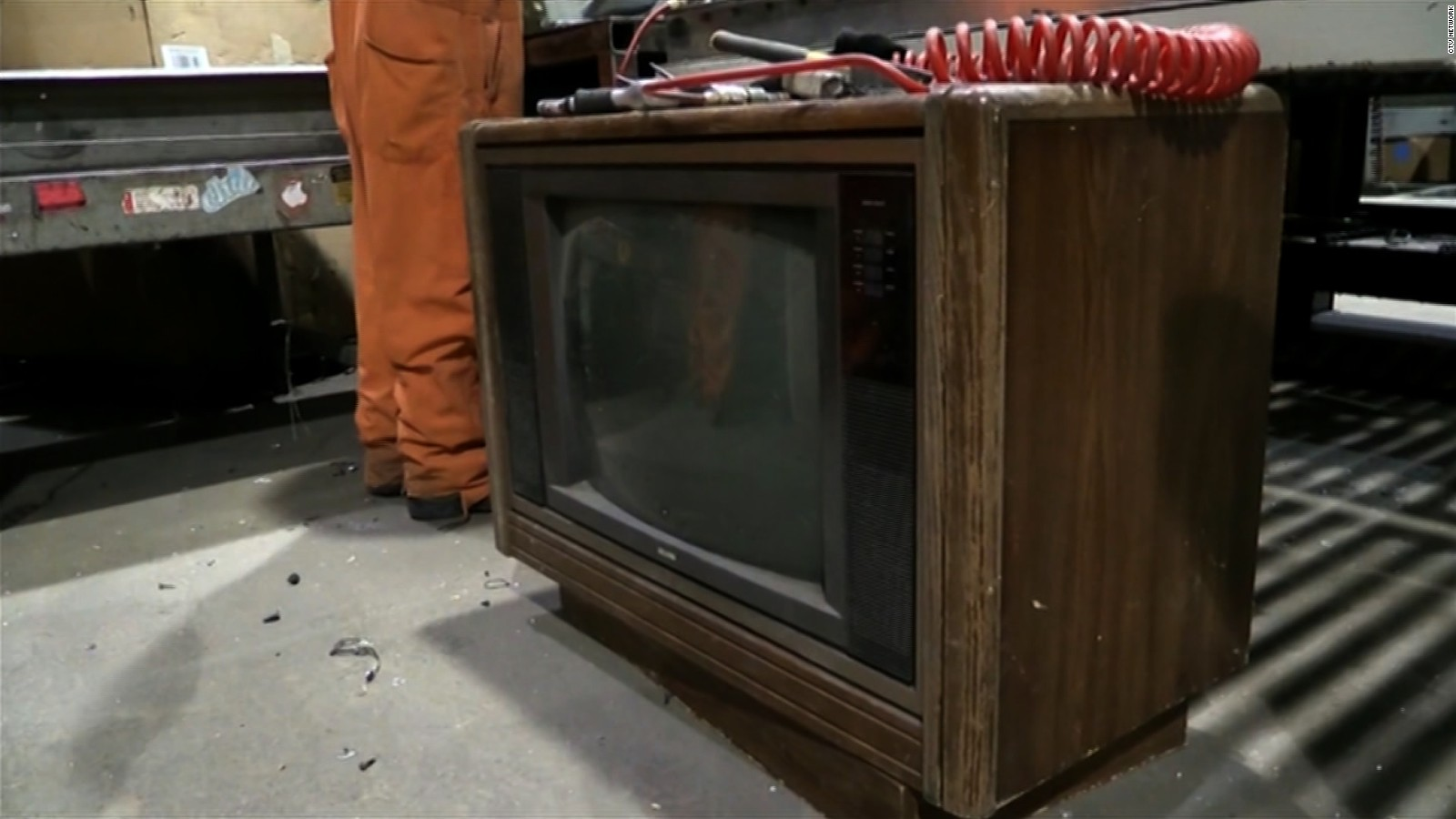 more than 100 000 found in old tv set cnn video