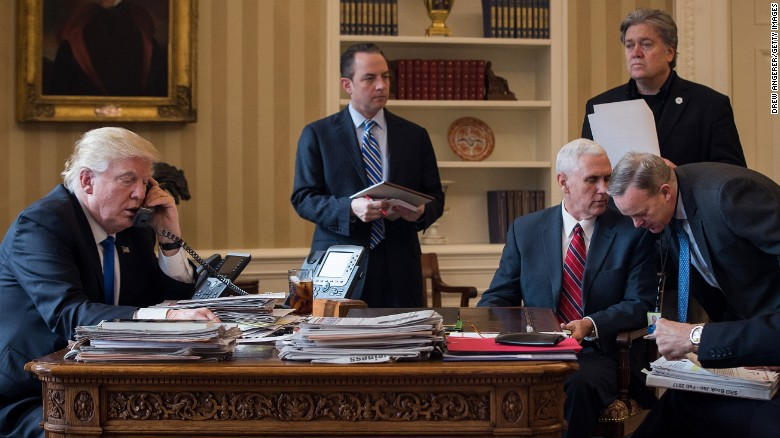 WASHINGTON, DC - JANUARY 28: President Donald Trump speaks on the phone with Russian President Vladimir Putin in the Oval Office of the White House, January 28, 2017 in Washington, DC. Also pictured, from left, White House Chief of Staff Reince Priebus, Vice President Mike Pence, White House Chief Strategist Steve Bannon, and Press Secretary Sean Spicer. On Saturday, President Trump is making several phone calls with world leaders from Japan, Germany, Russia, France and Australia. (Photo by Drew Angerer/Getty Images)