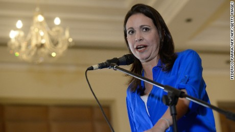 Venezuelan opposition leader Maria Corina Machado speaks during a press conference in Caracas on July 15, 2015. Former lawmaker Machado, who was expelled from the National Assembly in March 2014 and faces charges of conspiring against the government, said yesterday that the comptrollers office informed her, without much explanation, that she has been barred her from holding public office for the next 12 months. With this, Machado won't be allowed to take her seat would she win one in Decembers parliamentary election. The prominent opposition ally has 15 days to appeal the decision.   AFP PHOTO / FEDERICO PARRA        (Photo credit should read FEDERICO PARRA/AFP/Getty Images)
