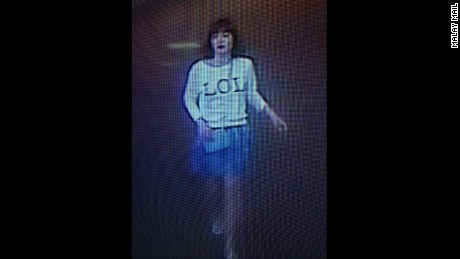 "This photo of closed circuit television footage shows a woman wearing a shirt with ""LOL"" on it in Sepang, Malaysia, on Monday, February 13."
