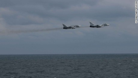 Two Russian Su-24 jets pass close to the USS Porter in the Black Sea last week.