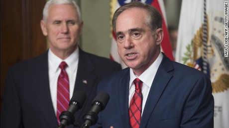 Secretary of Veterans Affairs David Shulkin speaks alongside US Vice President Mike Pence (L) during a ceremony in the Eisenhower Executive Office Building adjacent to the White House in Washington, DC, February 14, 2017. / AFP / SAUL LOEB        (Photo credit should read SAUL LOEB/AFP/Getty Images)