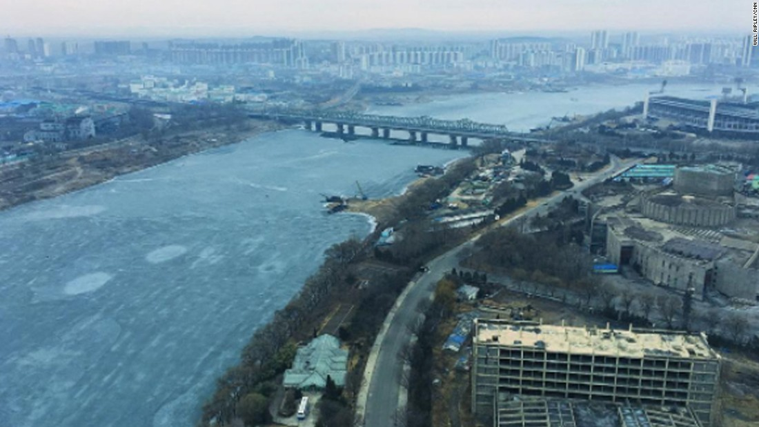 Ice flows down the Taedong River in Pyongyang on February 16.