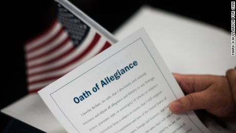 The citizenship packet contains a card-sized Oath of Allegiance.
