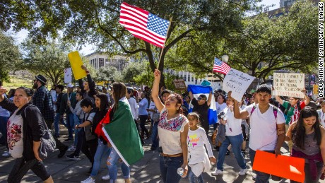 AUSTIN, TX - FEBRUARY 16:  Protesters march in the streets outside the Texas State Capital on 'A Day Without Immigrants' February 16, 2017 in Austin, Texas.  The crowd, which grew to well over a thousand participants, marched from the Austin City Hall to the Texas State Capital. Across the country hundreds of restaurants and eateries are closing for the day to protest President Trump's immigration policies and to highlight the contributions of immigrants to U.S. business and life.  (Photo by Drew Anthony Smith/Getty Images)