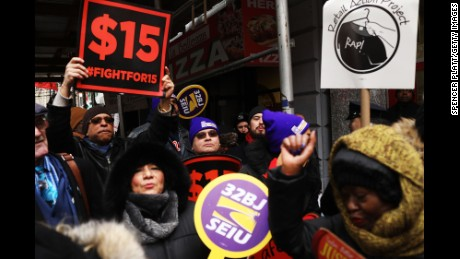 NEW YORK, NY - FEBRUARY 13:  Protesters with NYC Fight for $15 gather in front of a McDonalds to rally against fast food executive Andrew Puzder, who is President Donald Trump's nomination to lead the Labor Department on February 13, 2017 in New York City. Puzder's fast food business, including Hardee's and Carl's Jr., have a mixed record with workers, with many claiming him hostile to workers rights.  (Photo by Spencer Platt/Getty Images)