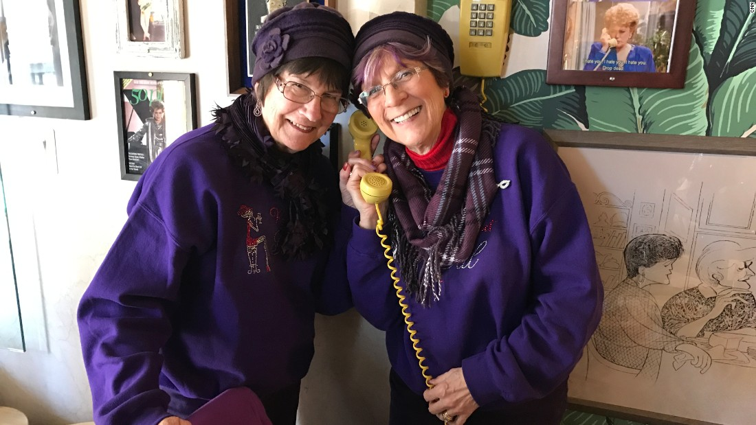 "Diane Pape (right) from Saginaw, Michigan, says she's ""the Rose character"" from ""The Golden Girls,"" while her friend is ""the Blanche,"" during a recent visit to the Rue de la Rue Café."