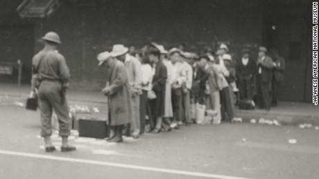 Japanese-Americans line up in Los Angeles for transport to the Santa Anita Race Track in April 1942.