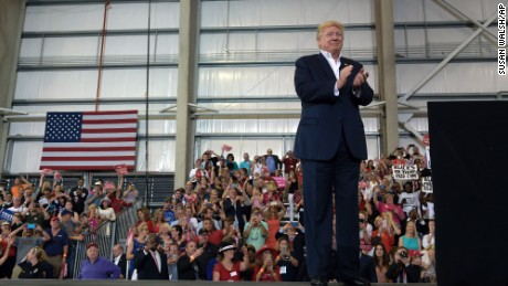 "President Donald Trump waits to speak at his ""Make America Great Again Rally"" at Orlando-Melbourne International Airport in Melbourne, Fla., Saturday, Feb. 18, 2017. Trump is launching his 2020 re-election campaign just 1,354 days before the 2020 election. (AP Photo/Susan Walsh)"