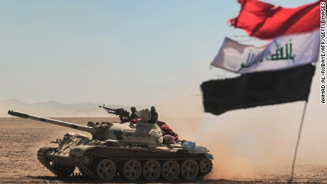 Tanks and armored vehicles of the Iraqi forces, supported by the Hashed al-Shaabi paramilitaries, advance towards the village of Sheikh Younis, south of Mosul, as the offensive to retake the western side of Mosul from Islamic State group fighters commenced on February 19, 2017.