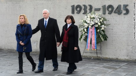 Vice President Mike Pence, wife Karen, and daughter Charlotte after laying a wreath Sunday at a former Nazi concentration camp in Dachau, Germany.