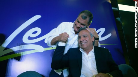 Ecuadorian President Rafael Correa (L) hugs Lenin Moreno, the presidential candidate of the governing Alianza PAIS party, at a hotel in Quito after the exit polls indicate that the leftist candidate won the first round of the elections on February 19, 2017.  / AFP / RODRIGO BUENDIA        (Photo credit should read RODRIGO BUENDIA/AFP/Getty Images)