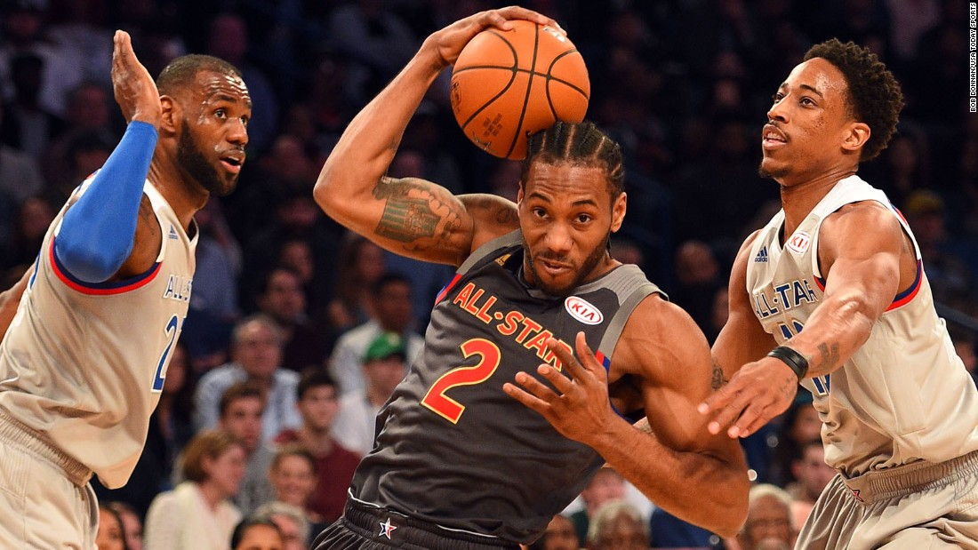 The game included somewhat less intense defense on both teams than in previous years. Nonetheless, this drive to the basket by Western forward Kawhi Leonard was met by Eastern guard DeMar DeRozan, right, and  Eastern forward LeBron James.