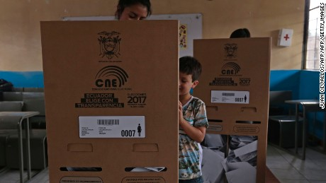 A woman votes at a polling station in Guayaquil during Ecuador's general elections on February 19, 2017. Ecuador's elections will decide who succeeds leftist President Rafael Correa after a decade in power. / AFP / Juan Cevallos        (Photo credit should read JUAN CEVALLOS/AFP/Getty Images)
