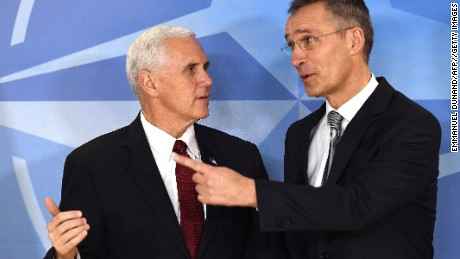 US Vice-President Mike Pence is welcomed by NATO Secretary General Jens Stoltenberg at NATO headquarters in Brussels on February 20.