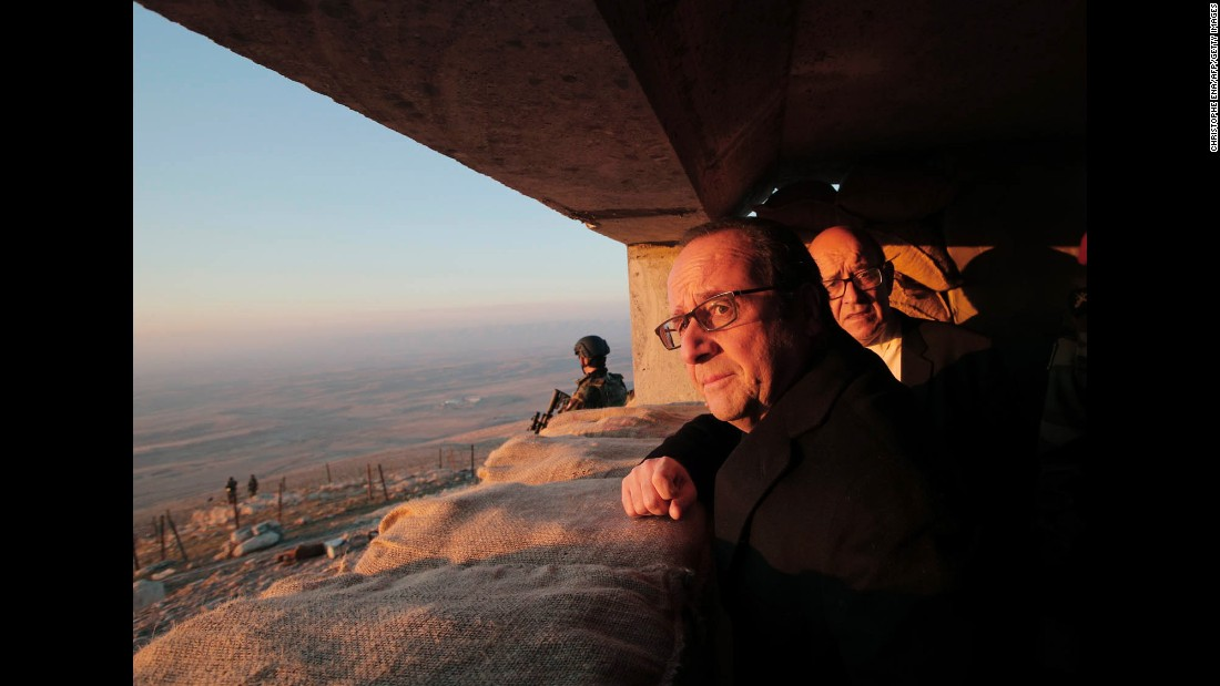 French President Francois Hollande and French Defense Minister Jean-Yves Le Drian, right, view territory held by ISIS during a visit to a military outpost near Mosul on Monday, January 2.