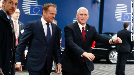 US Vice President Mike Pence (R) walks with European Council head Donald Tusk (L) prior to their meeting at the European Commission in Brussels on February 20, 2017.
