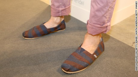 MIAMI BEACH, FL - DECEMBER 04:  Daniel Schaeffer (shoe detail), wearing TOMS shoes, attends Art Basel Miami Beach 2013 at the Miami Beach Convention Center on December 4, 2013 in Miami Beach, Florida.  (Photo by Aaron Davidson/Getty Images)