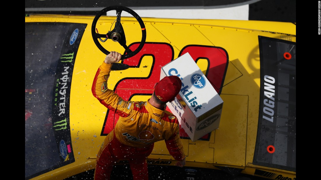 "NASCAR driver Joey Logano celebrates Sunday, February 19, after he won ""The Clash"" exhibition race in Daytona Beach, Florida."