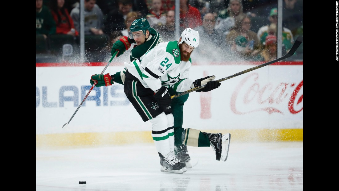 Dallas defenseman Jordie Benn, foreground, checks Minnesota forward Nino Niederreiter during an NHL game in St. Paul, Minnesota, on Thursday, February 16.