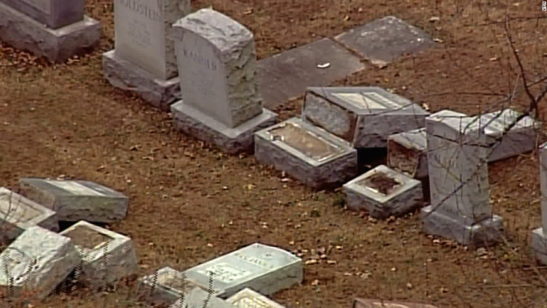 Pence, Missouri governor join cleanup at vandalized Jewish cemetery