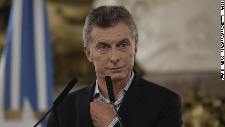 Argentina's President Mauricio Macri gestures during a press conference at the Casa Rosada in Buenos Aires on February 16, 2017. Among other topics he mentioned, Macri announced that he had ordered the negotiation of a new deal to settle debts incurred by the postal service in a period when it was controlled by his father's business, which triggered a scandal due to a suspected conflict of interest. / AFP / JUAN MABROMATA        (Photo credit should read JUAN MABROMATA/AFP/Getty Images)