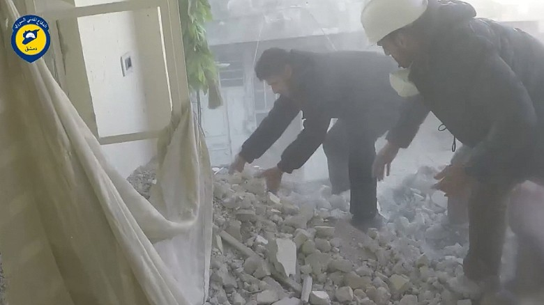 Moment rescuers spot girl buried under rubble