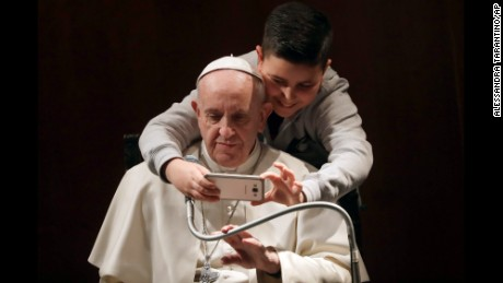 A boy takes a selfie with Pope Francis, during a visit to the parish of Santa Maria Josefa del Cuore di Gesu', in Rome, Sunday, Feb. 19, 2017. (AP Photo/Alessandra Tarantino)
