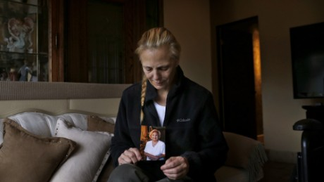 Bobbi Young holds a photo of her mother, Marilyn Young, the day after she passed away at home in Carmel Valley, California.