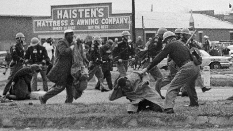 State troopers swing billy clubs to break up a civil rights voting march in Selma, Ala., March 7, 1965. John Lewis, chairman of the Student Nonviolent Coordinating Committee (in the foreground) is being beaten by a state trooper. Lewis, a future U.S. Congressman sustained a fractured skull. (AP Photo)