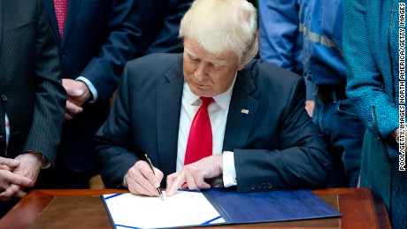 Trump signs MLK Jr. proclamation amid cries of racism
