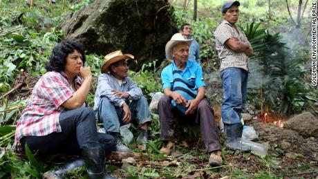 Berta  Cáceres, left, on the banks of the Gualcarque River in western Honduras, where she led the indigenous Lenca people in opposition to the Agua Zarca hydroelectric project.