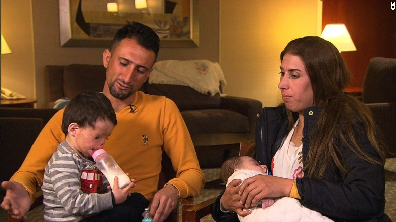 Burned Iraqi toddler reunited with family