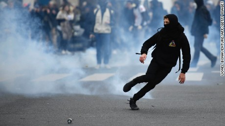 Students protest against the police in Paris Thursday.