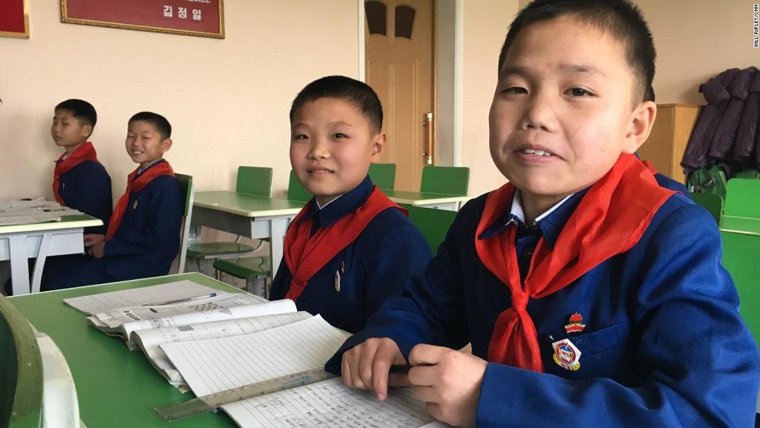 Boys in Pyongyang pose for a photo at a secondary school for orphans on February 19.