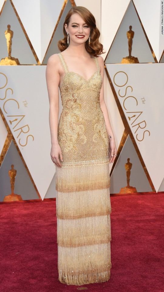 Emma Stone walks the red carpet before the Academy Awards on Sunday, February 26.