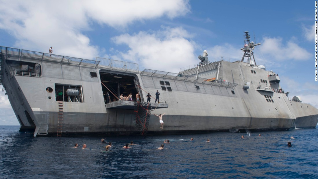 Sailors assigned to the littoral combat ship USS Coronado (LCS 4) swim in the South China Sea on February 23. The littoral combat ship, operating out of Singapore, has been conducting exercises and training in the South China Sea all month.