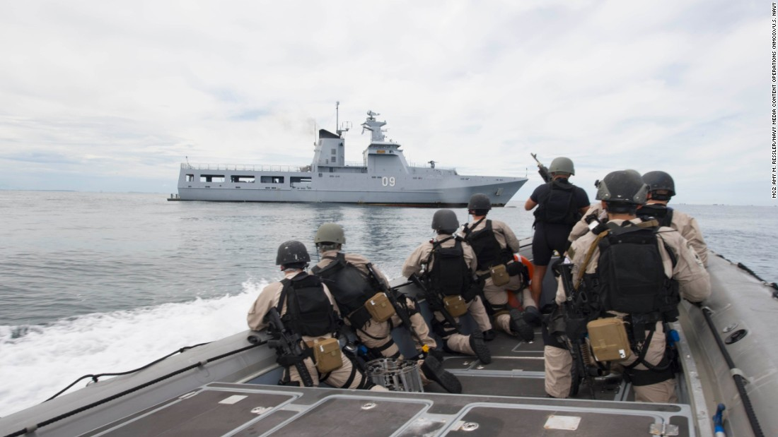 Sailors assigned to the littoral combat ship USS Coronado prepare to conduct a visit, board, search and seizure exercise with the Royal Brunei Navy Patrol Vessel DARUTTAQWA on February 19.