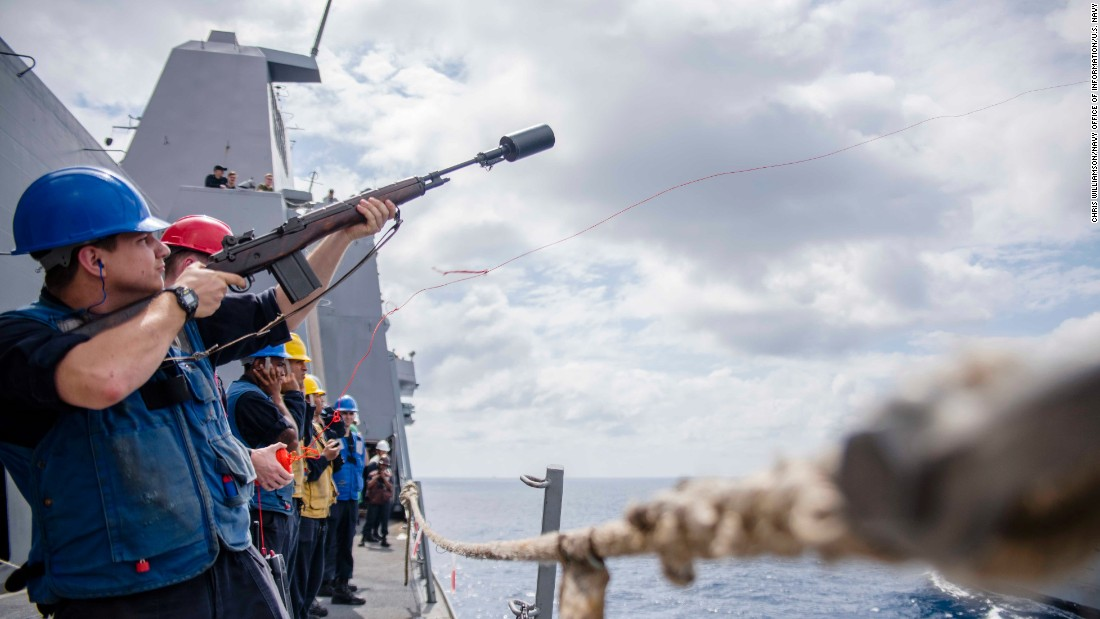 Gunner's Mate 3rd Class Tyler Hall, from Jonesborough, Tennessee, fires a shot line from the amphibious transport dock ship USS Green Bay to the Military Sealift Command fleet replenishment oiler USNS Tippecanoe during a replenishment-at-sea on February 7.