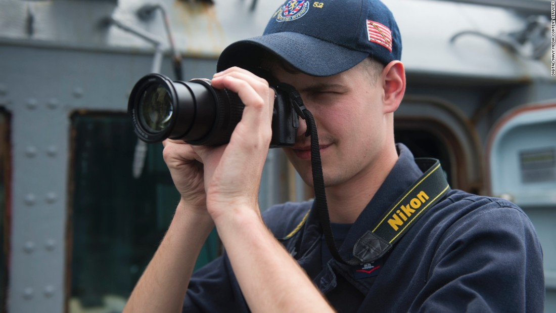 Operations Specialist 3rd Class Kyle Peters photographs a surface contact off the starboard side of the Arleigh Burke-class guided-missile destroyer USS Barry on February 8.