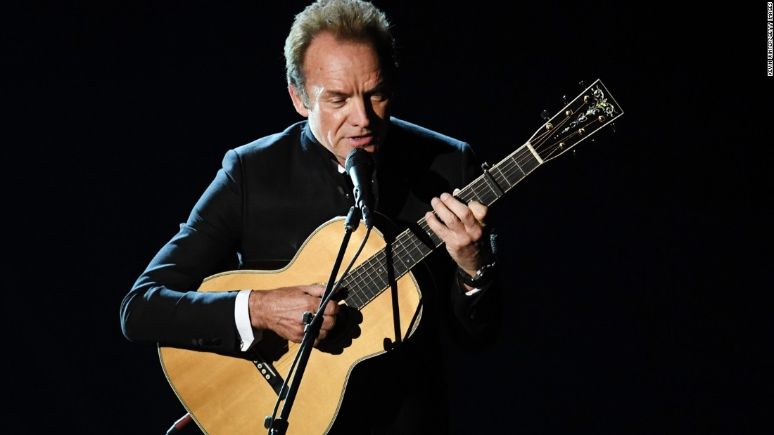 "Sting plays the guitar during a performance of ""The Empty Chair,"" a song from ""Jim: The James Foley Story."""