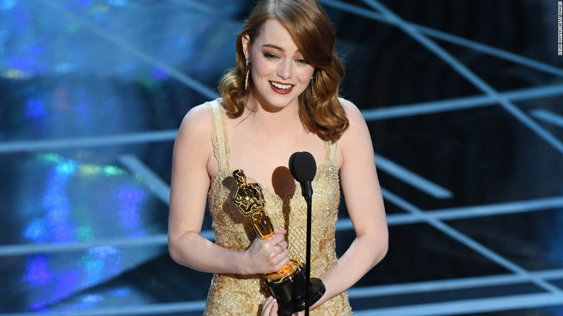 "Emma Stone accepts the award for her role in the musical ""La La Land,"" which was nominated for 14 Oscars and won six of them."