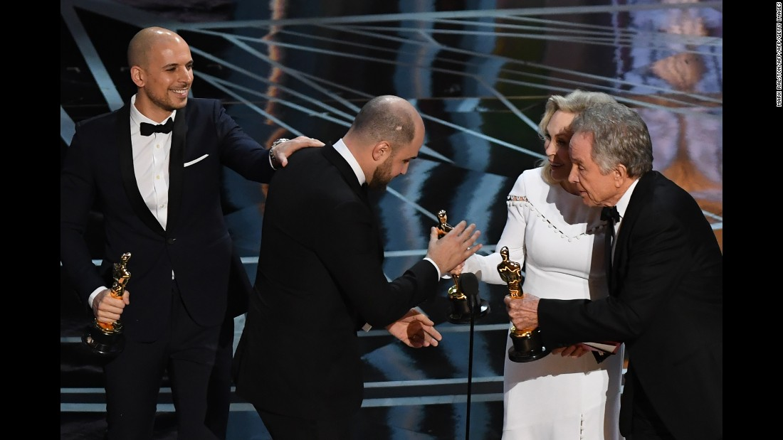 """La La Land"" producer Jordan Horowitz, center, accepts the award for best picture next to producer Fred Berger."
