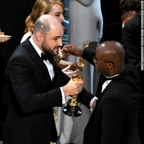 HOLLYWOOD, CA - FEBRUARY 26:  ''La La Land' producer Jordan Horowitz (L) hands over the Best Picture award to 'Moonlight' writer/director Barry Jenkins following a presentation error onstage during the 89th Annual Academy Awards at Hollywood & Highland Center on February 26, 2017 in Hollywood, California.  (Photo by Kevin Winter/Getty Images)